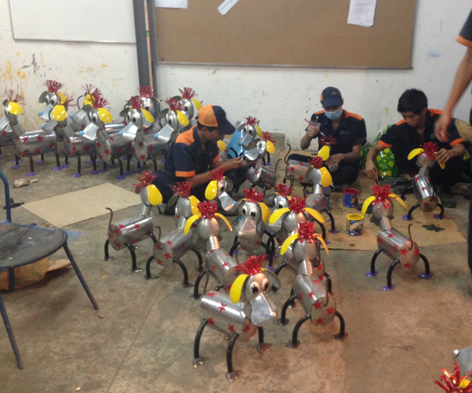 Recycled Garden Ornaments being painted