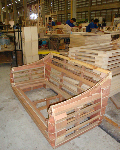 The hardwood frame is constructed by hand ...