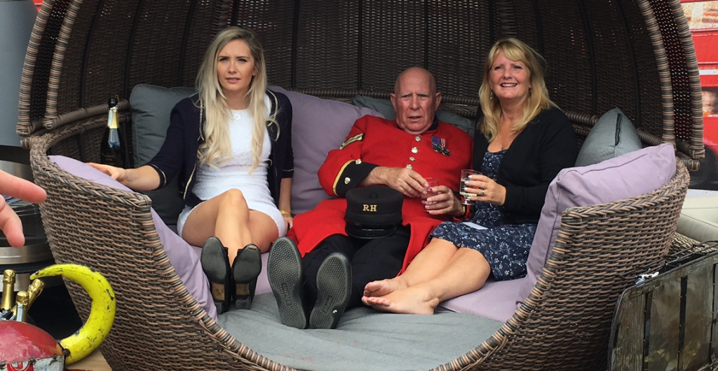 Dave the Chelsea Pensioner in the Apple Day Bed with the ladies