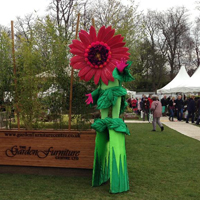 People dressed up as flowers at the Cardiff Trade Stand 2013