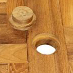 A lovely little teak plug is included for the parasol hole