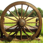 Genuine Ox Cart Wheel makes up the Back Rest