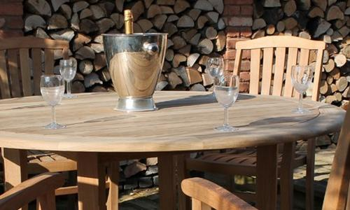 Westminster Teak Dining Set gleaming in the sun
